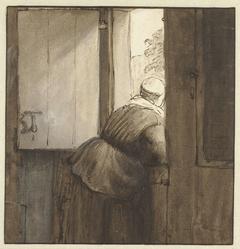 Vrouw over onderdeur geleund