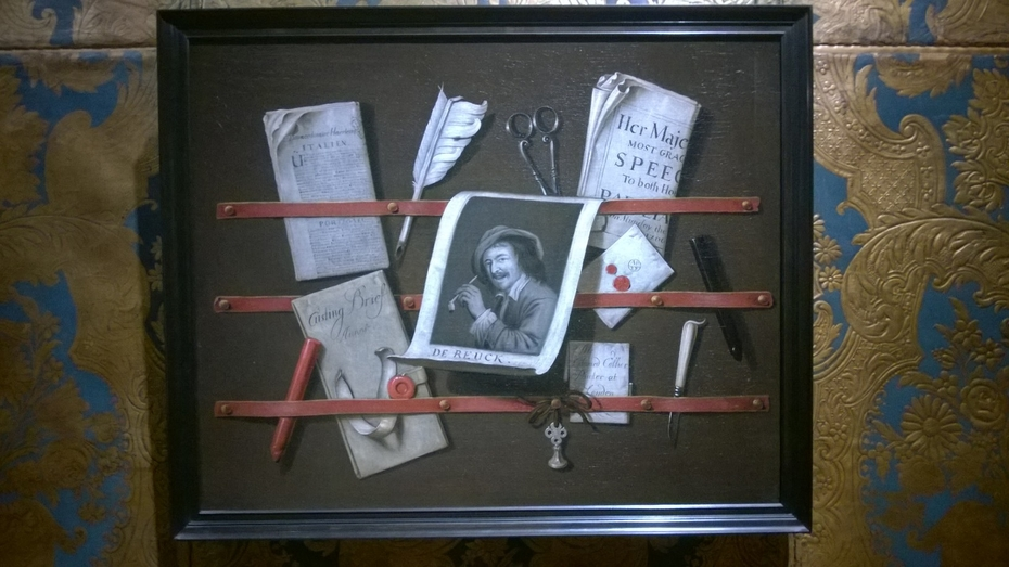 A trompe l'oeil of a letter rack with a print, a quill, sealing wax and a knife