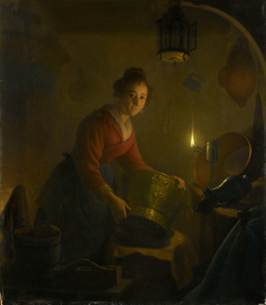A Woman in a Kitchen by Candlelight