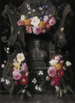 Flowers on a relief with a niche containing a bust of Flora