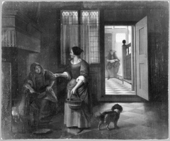 Interior with two women talking, a man and a dog