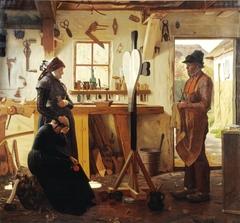 To kvinder besøger landsbykunstneren for at se det bestilte gravkors