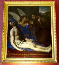 Un ange montre à saint François d'Assise le Christ détaché de la croix
