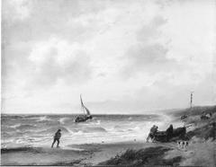 Vissers halen een boot op het strand