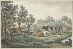 Wei met koeien die gemolken worden
