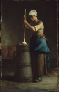 Young Woman Churning Butter