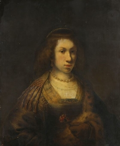 Young woman holding a carnation