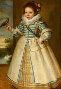 A Young Girl holding a Chaffinch
