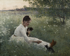 Girl with cats in a summer landscape