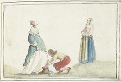 Heer strikt de schoen van een dame