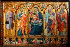 La vierge allaitant entourée de plusieurs saints