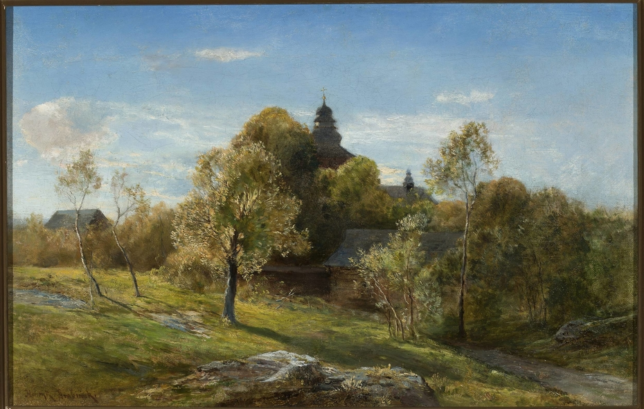 Landscape with a church hidden behind the trees