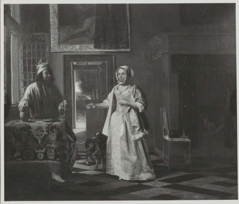Man with a glass and a jug and a woman lacing het bodice
