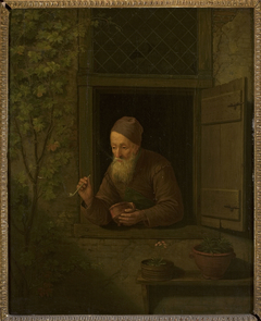 Old man with a pipe in the window