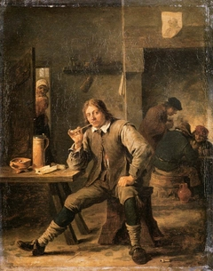 Smoker Leaning His Elbow on a Table