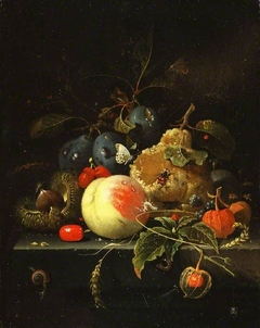 Still-life: fruit and nuts on a stone ledge