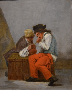 Two young soldiers drinking from a jug