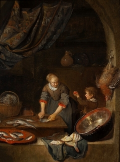 Woman flaying a fish and a child