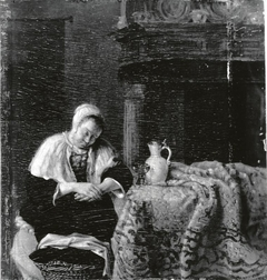 A woman asleep at a table