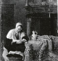 A woman asleep at a table