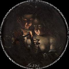 Boy and girl, lighting a candle