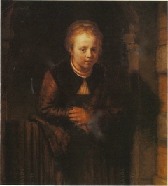 Girl at a half-open door