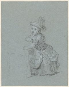 Staand kind, zich vasthoudend aan een stoel
