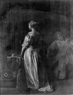 Standing woman with a woman playing the cello