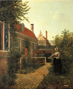 Woman with basket of beans in the kitchen garden